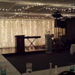 Twinkle hanging lights & Sheer white twinkle backdrop for your church event!